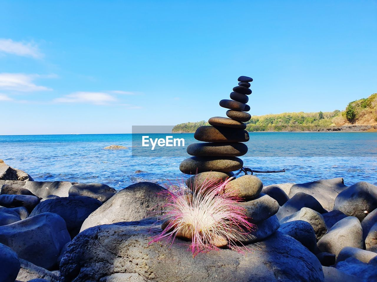 water, sea, sky, solid, rock, beach, beauty in nature, stone - object, horizon, horizon over water, rock - object, scenics - nature, tranquility, nature, land, stack, tranquil scene, balance, zen-like, pebble, no people, outdoors