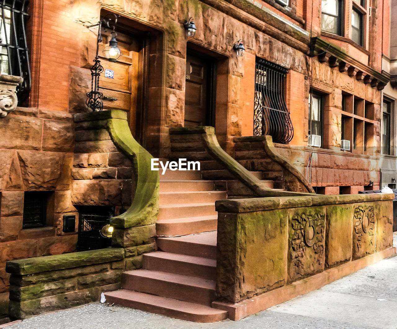 architecture, built structure, building exterior, staircase, building, steps and staircases, no people, day, railing, window, wall, outdoors, residential district, wall - building feature, city, direction, nature, sunlight, wood - material, the past, alley