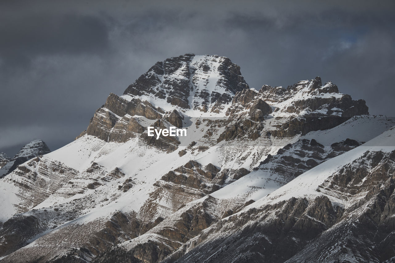 mountain, cold temperature, cloud - sky, sky, winter, snow, scenics - nature, beauty in nature, mountain range, tranquil scene, snowcapped mountain, tranquility, nature, mountain peak, no people, day, non-urban scene, rock, environment, outdoors, formation, extreme weather