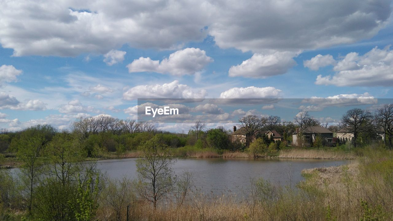 sky, tree, cloud - sky, water, nature, lake, scenics, beauty in nature, no people, tranquility, outdoors, landscape, tranquil scene, day, grass, architecture