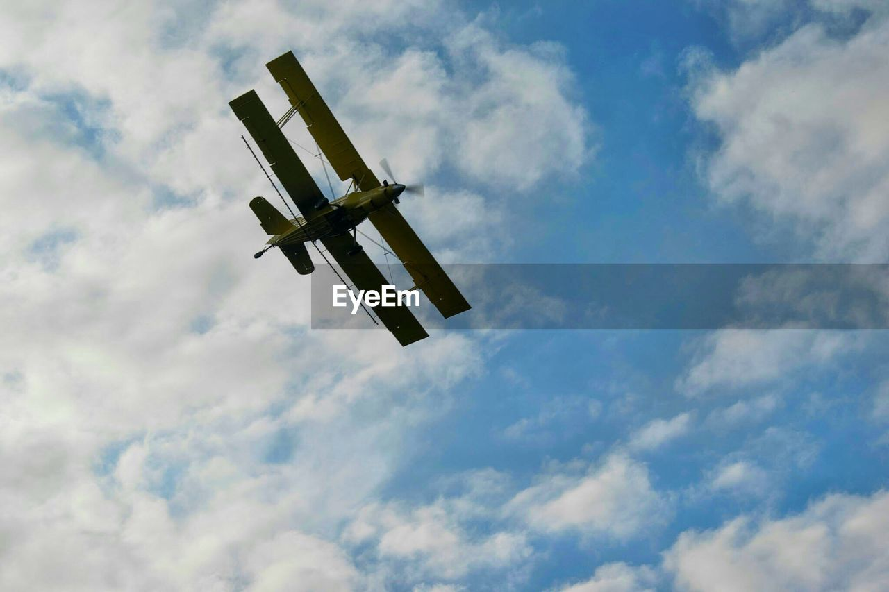 low angle view, cloud - sky, sky, airplane, flying, transportation, air vehicle, day, no people, journey, outdoors, mid-air, nature