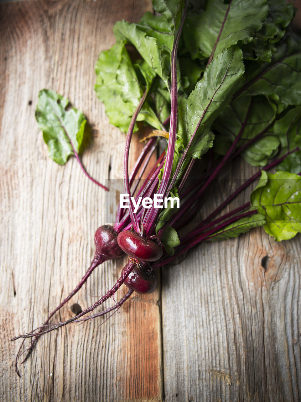 High angle view of beets on wooden table