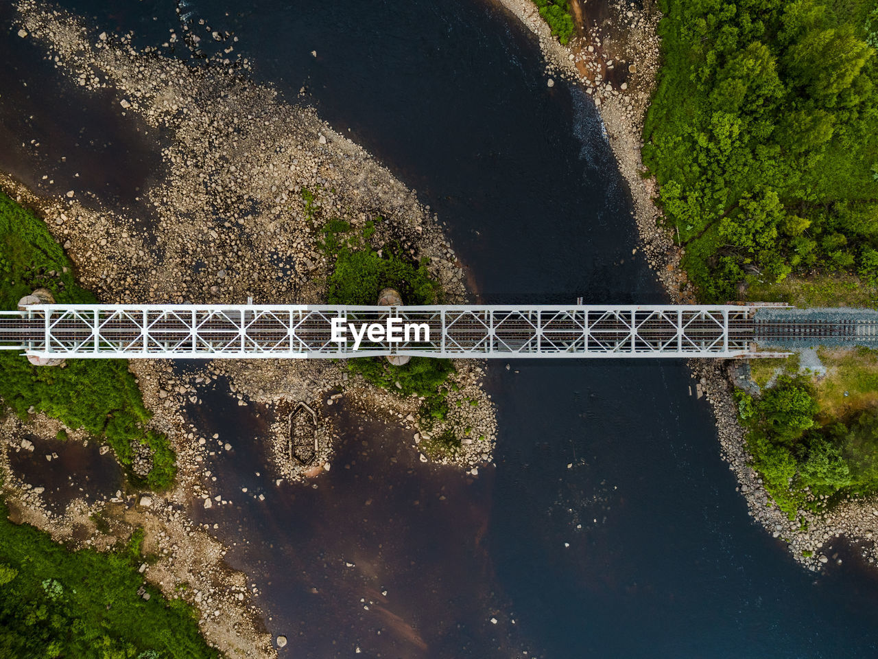 no people, nature, day, water, connection, transportation, outdoors, plant, high angle view, built structure, bridge, architecture, bridge - man made structure, road, sunlight, tree, metal, motion, land