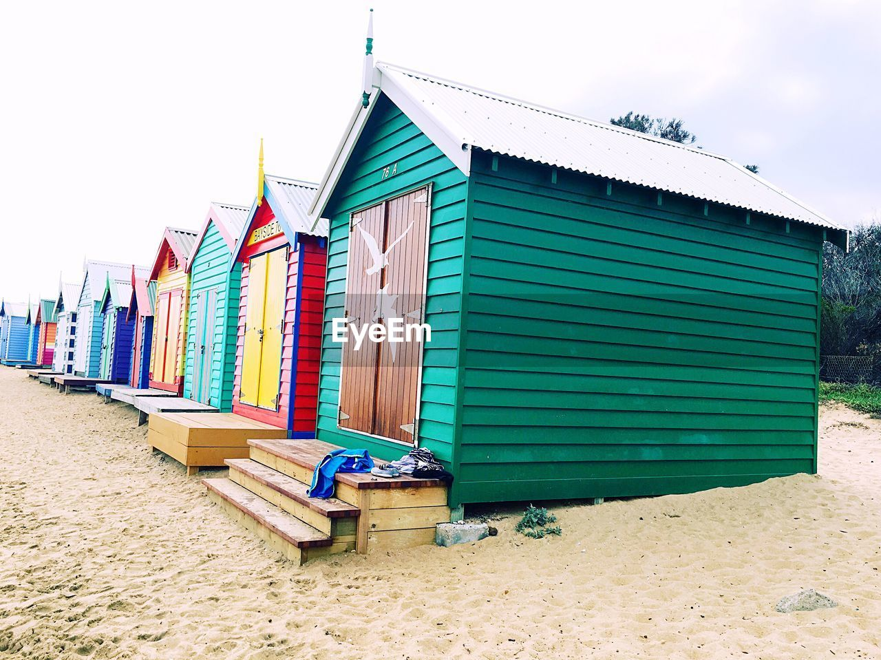 beach, sand, built structure, architecture, building exterior, outdoors, day, multi colored, green color, sky, no people, nature