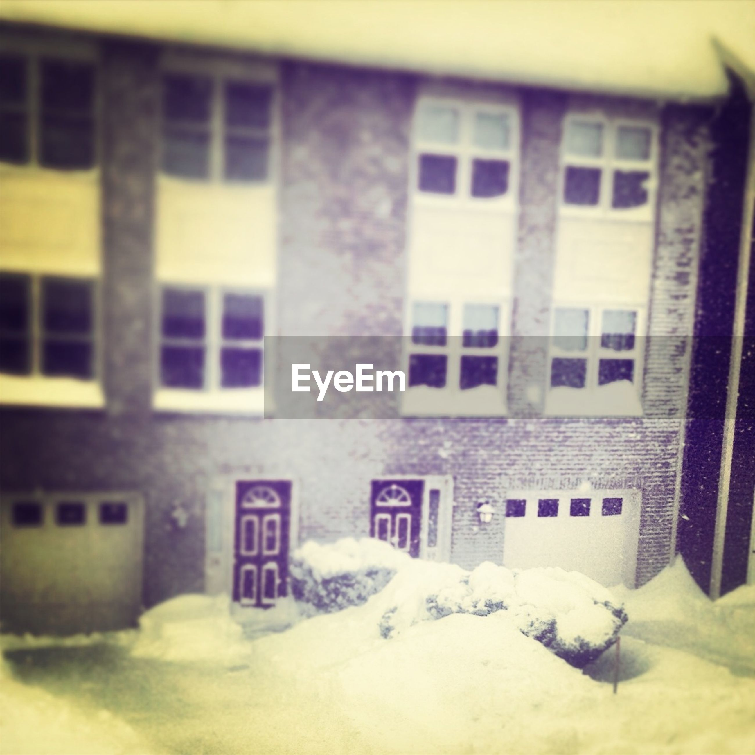 architecture, building exterior, built structure, window, text, building, western script, residential structure, snow, residential building, no people, day, glass - material, house, cold temperature, outdoors, winter, communication, wall - building feature, city