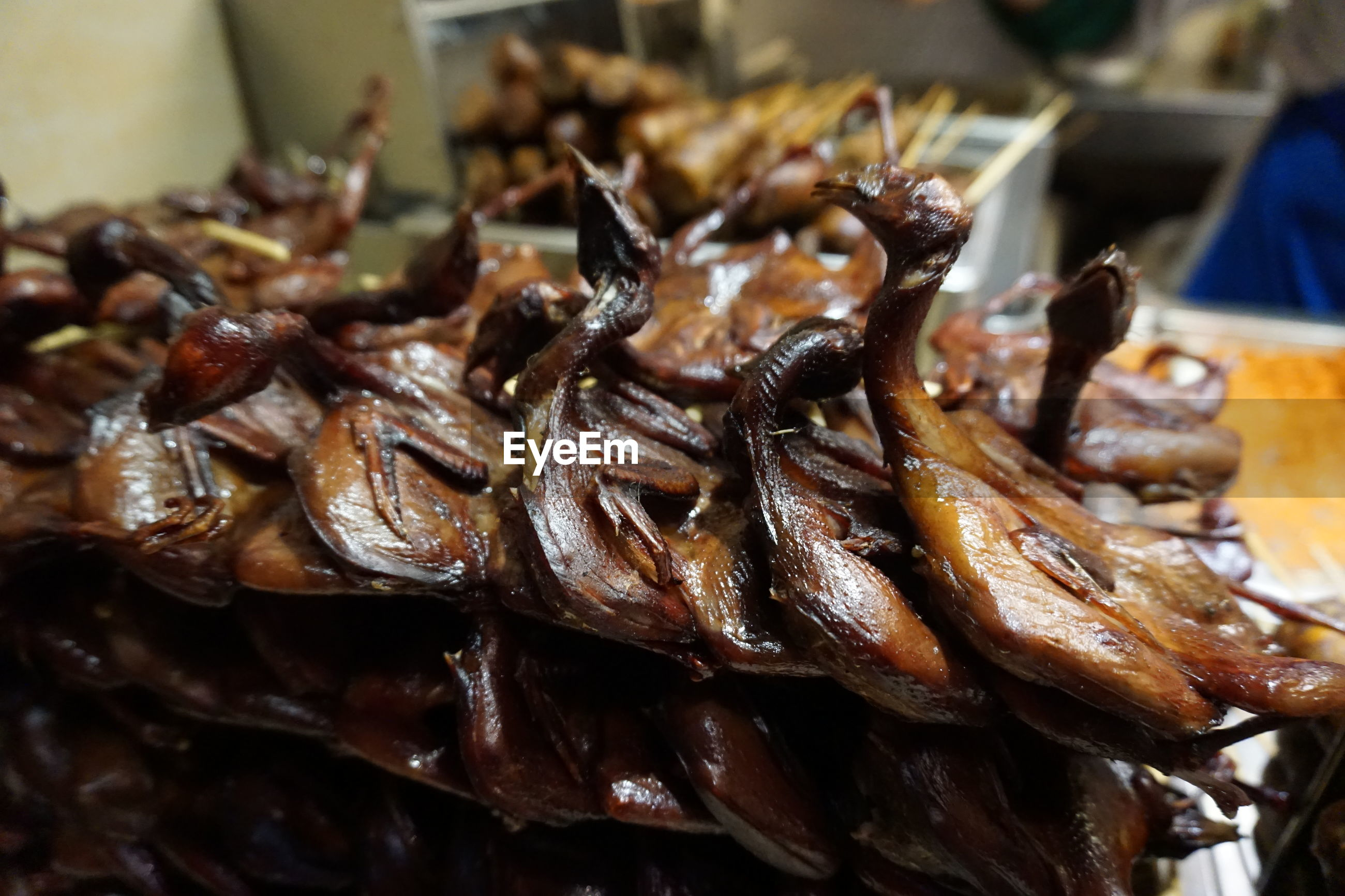 Roasted birds for sale at market stall