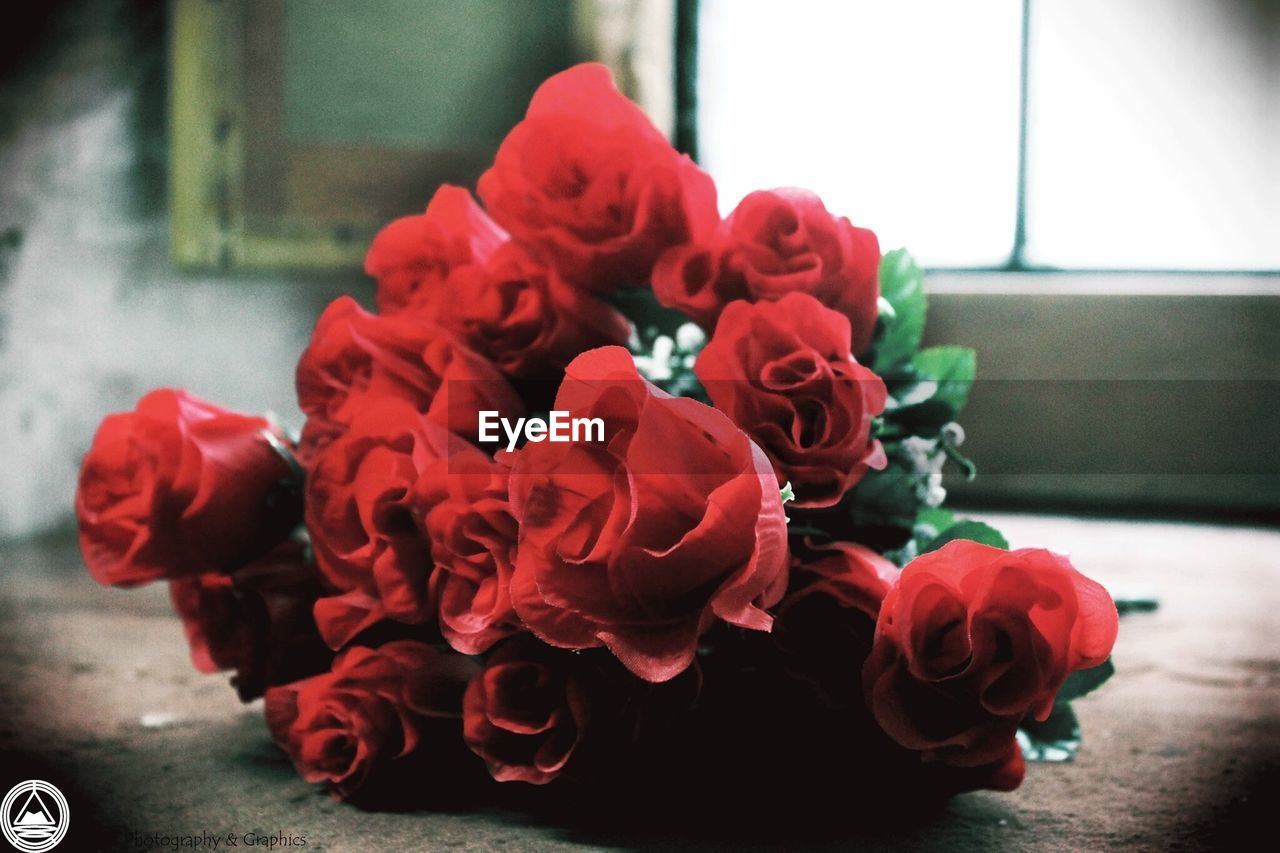 flower, rose - flower, red, petal, flower head, fragility, indoors, table, beauty in nature, no people, vase, close-up, bouquet, nature, freshness, day