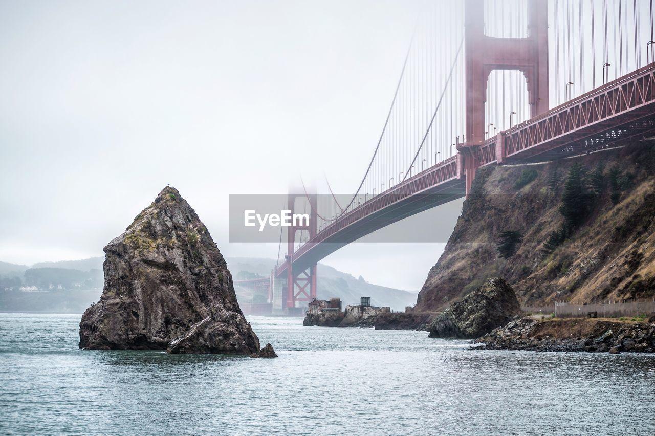 Rock Formation In San Francisco Bay By Golden Gate Bridge