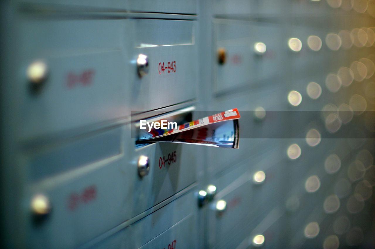 Close-Up Of Paper In Locker