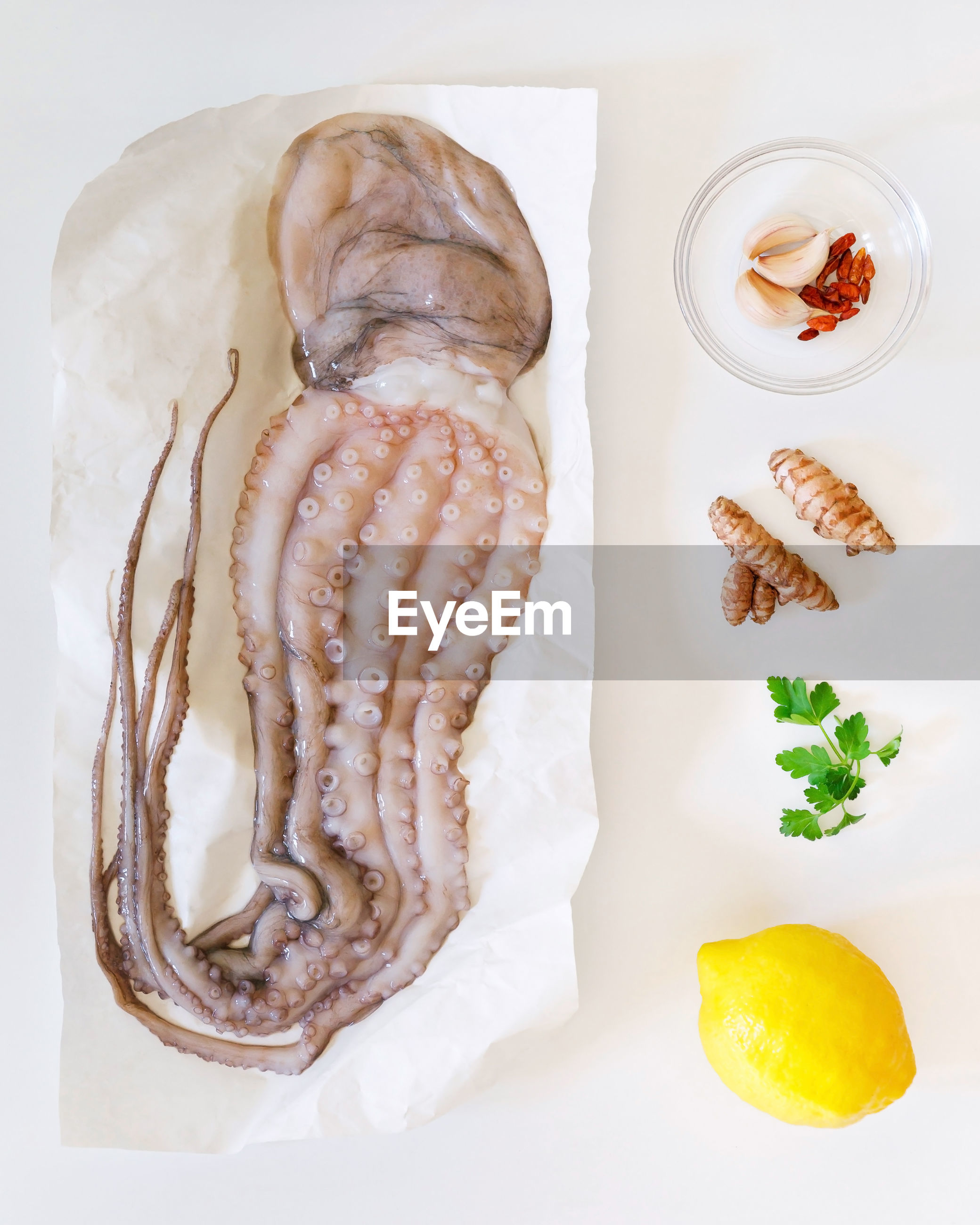 Directly above shot of octopus and ingredients on table