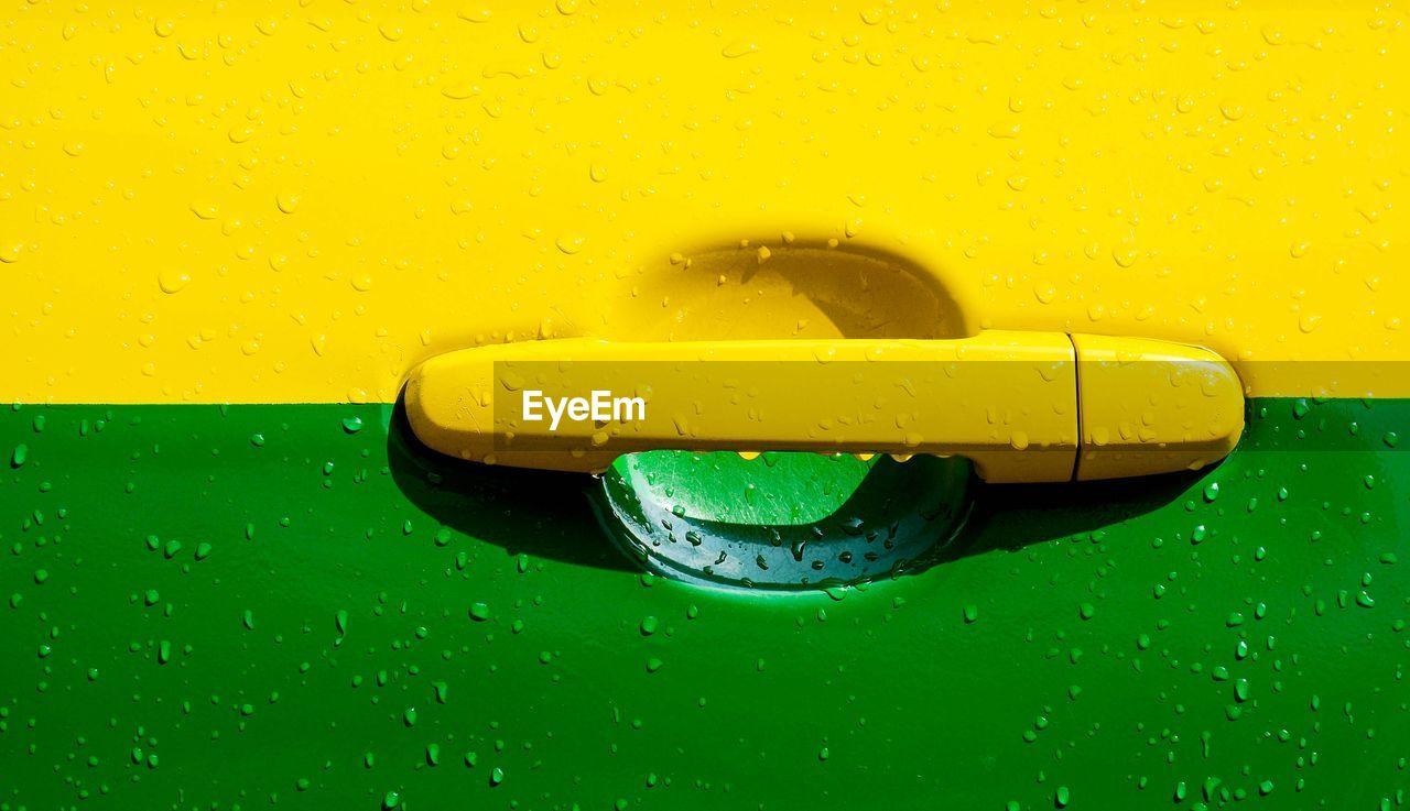 Close-up of wet car door