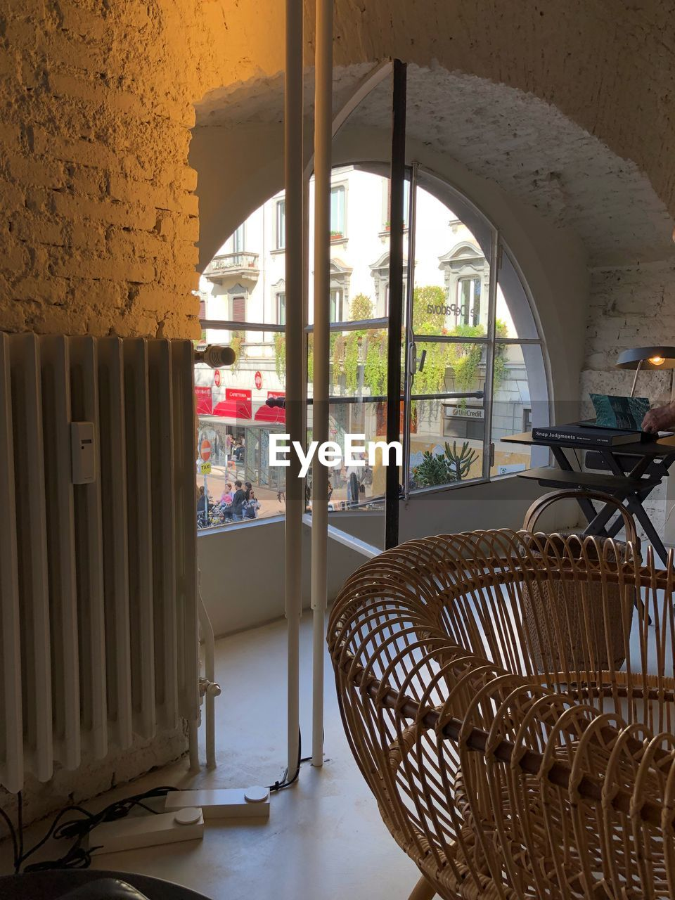 chair, indoors, seat, architecture, window, day, no people, table, built structure, basket, furniture, wicker, empty, absence, building, architectural column, glass - material, focus on foreground