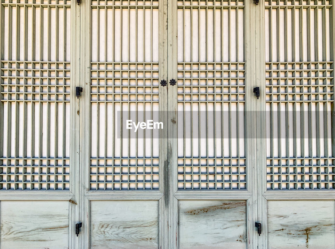 architecture, built structure, door, building exterior, no people, entrance, full frame, pattern, closed, backgrounds, day, building, safety, security, wood - material, window, protection, outdoors, wall - building feature, metal