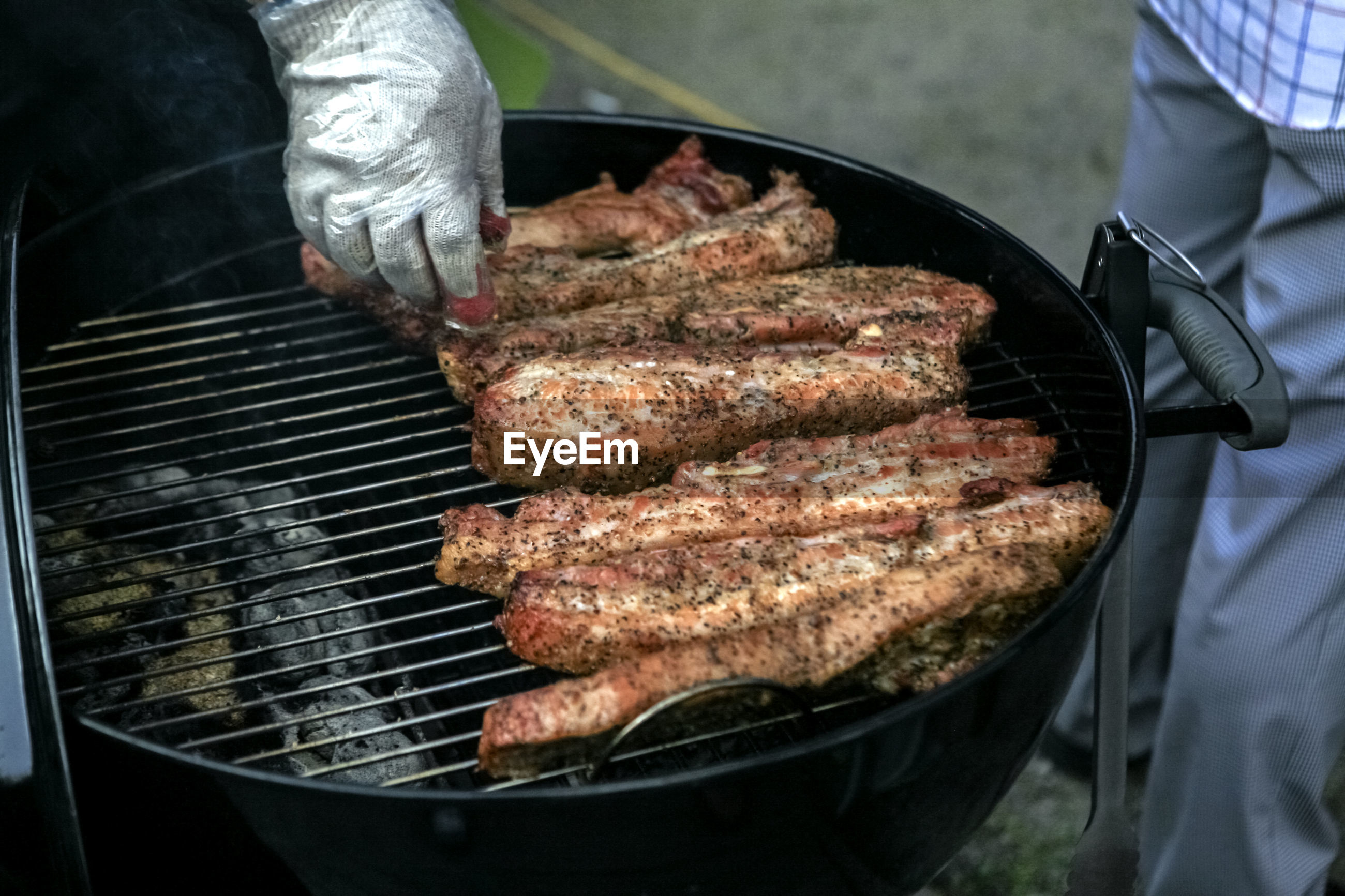 High angle view of meat grilling on barbeque grill