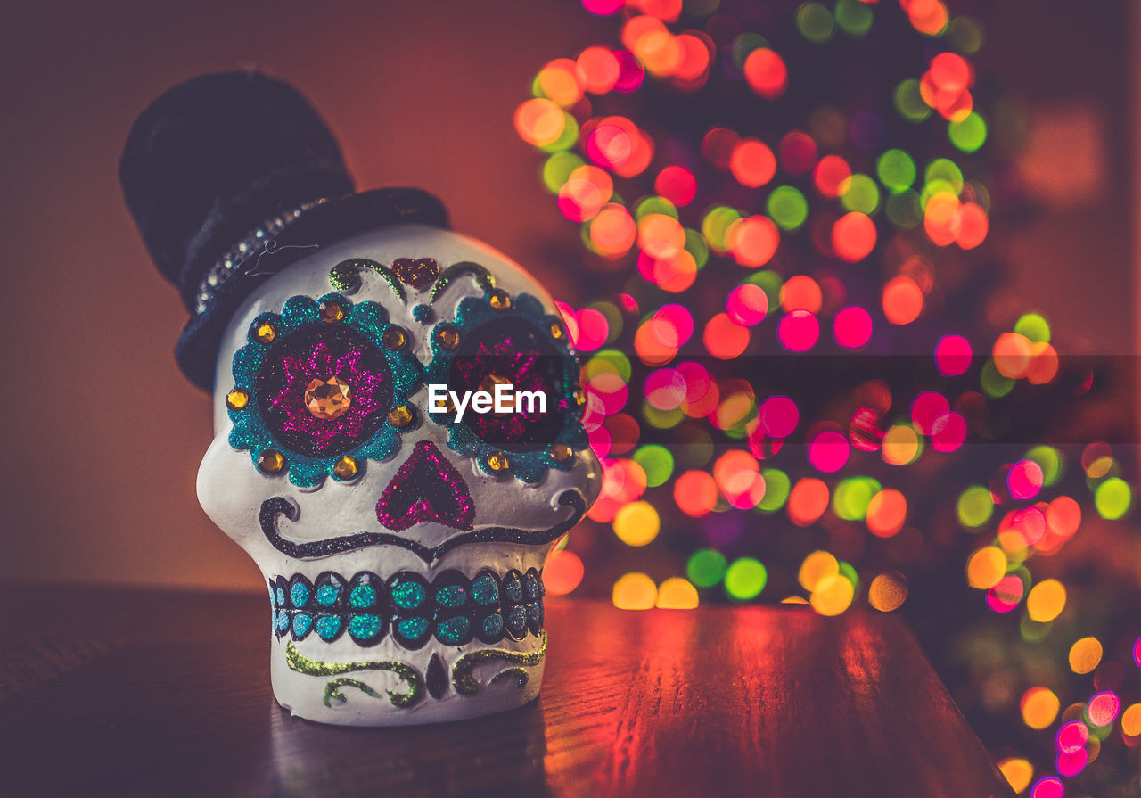 Close-Up Of Decorated Artificial Skull On Table