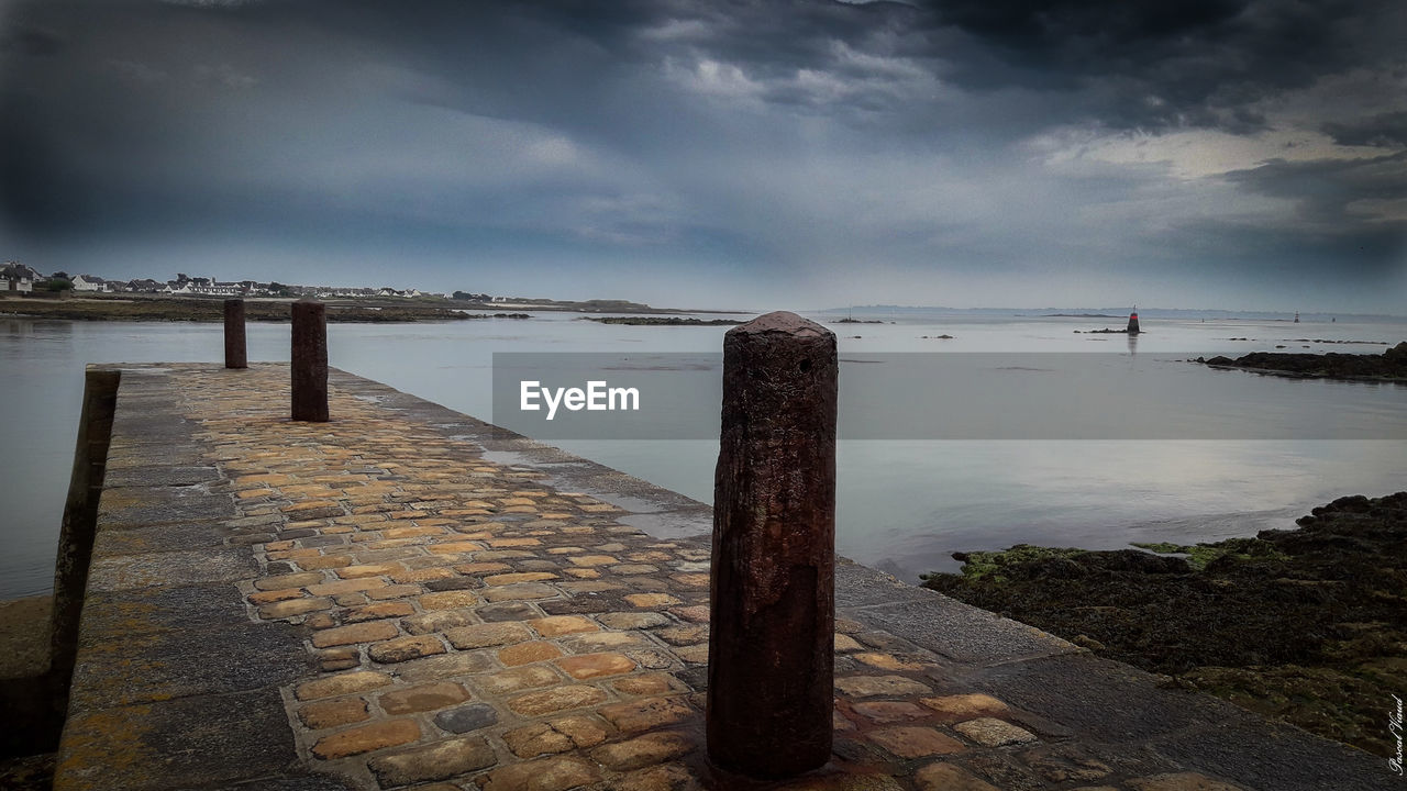 water, tranquility, tranquil scene, sky, outdoors, cloud - sky, day, nature, sea, scenics, beauty in nature, no people, groyne
