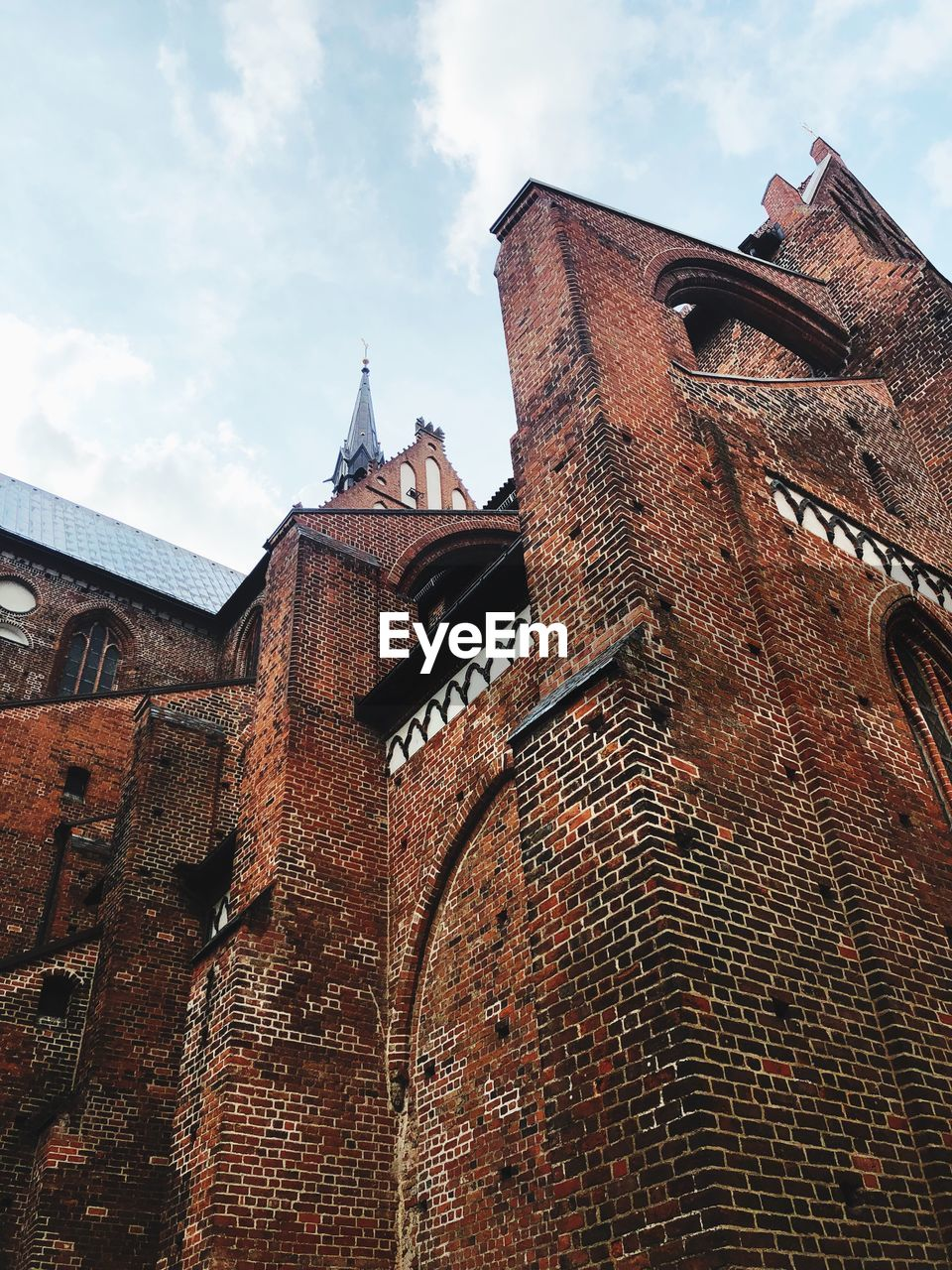 architecture, built structure, building exterior, low angle view, sky, building, the past, no people, history, religion, nature, brick, place of worship, wall, day, cloud - sky, brick wall, spirituality, belief, outdoors