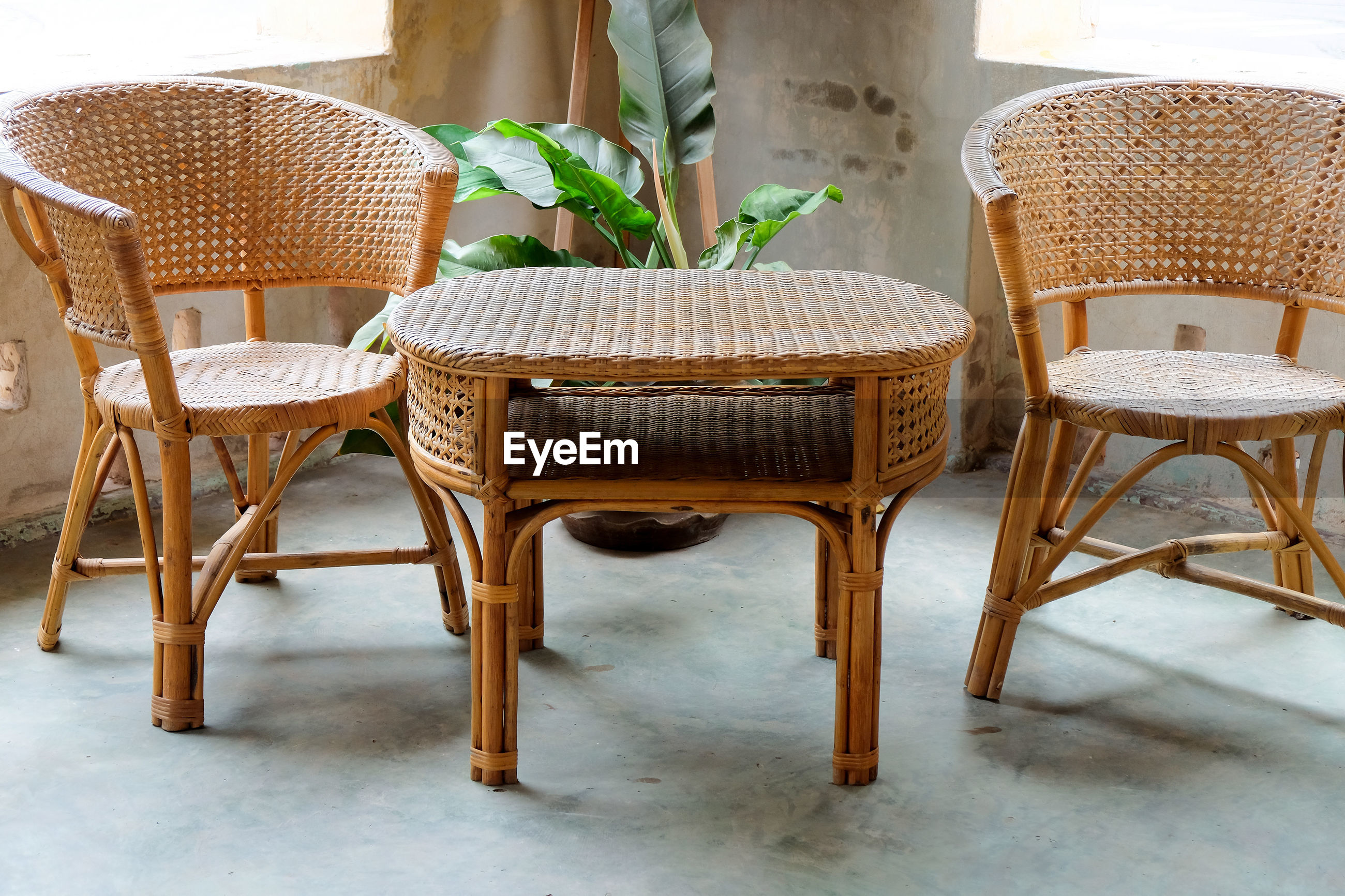 EMPTY CHAIRS AND TABLE IN BASKET