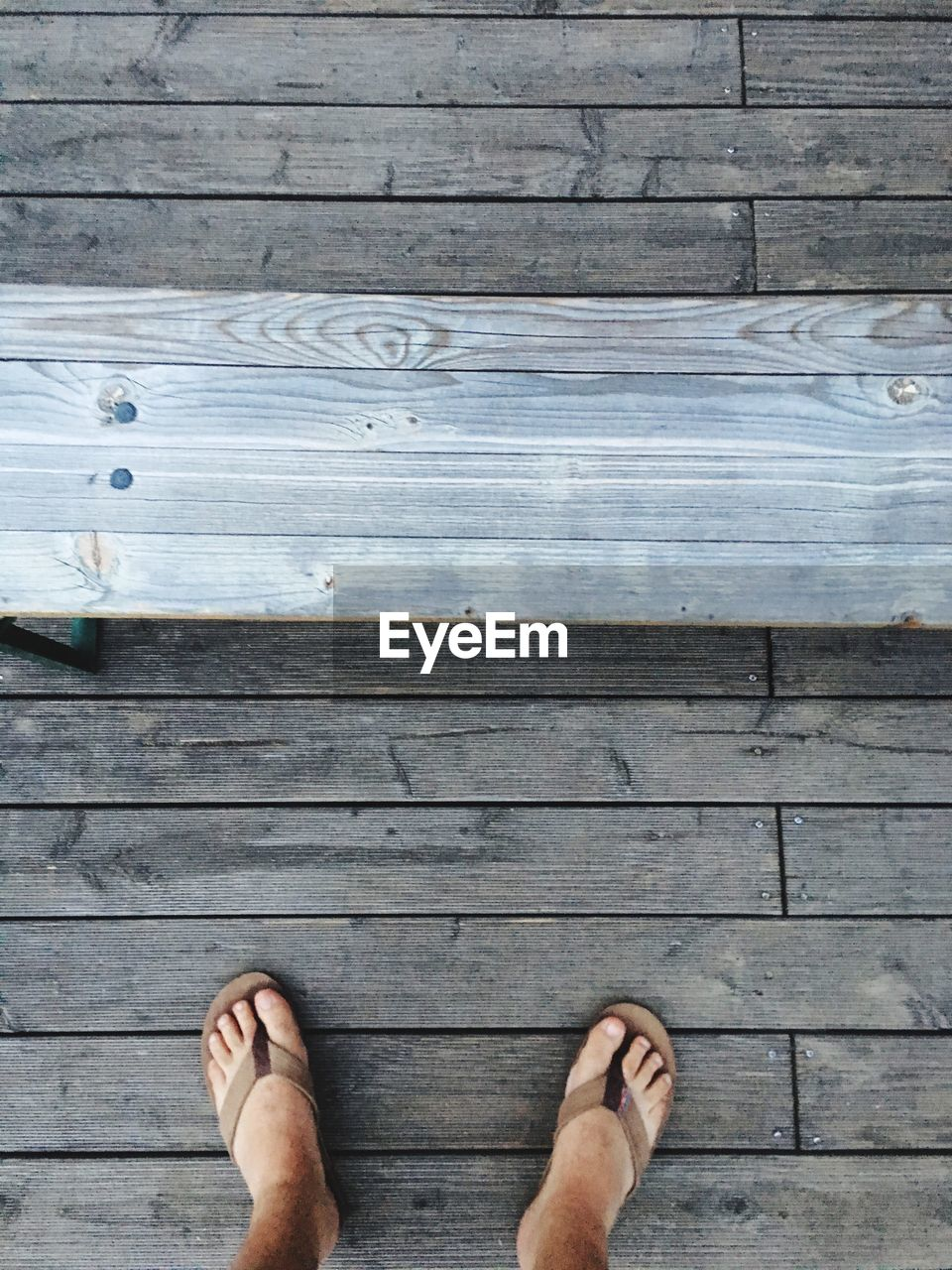 High Angle View Of Person Standing On Floorboard