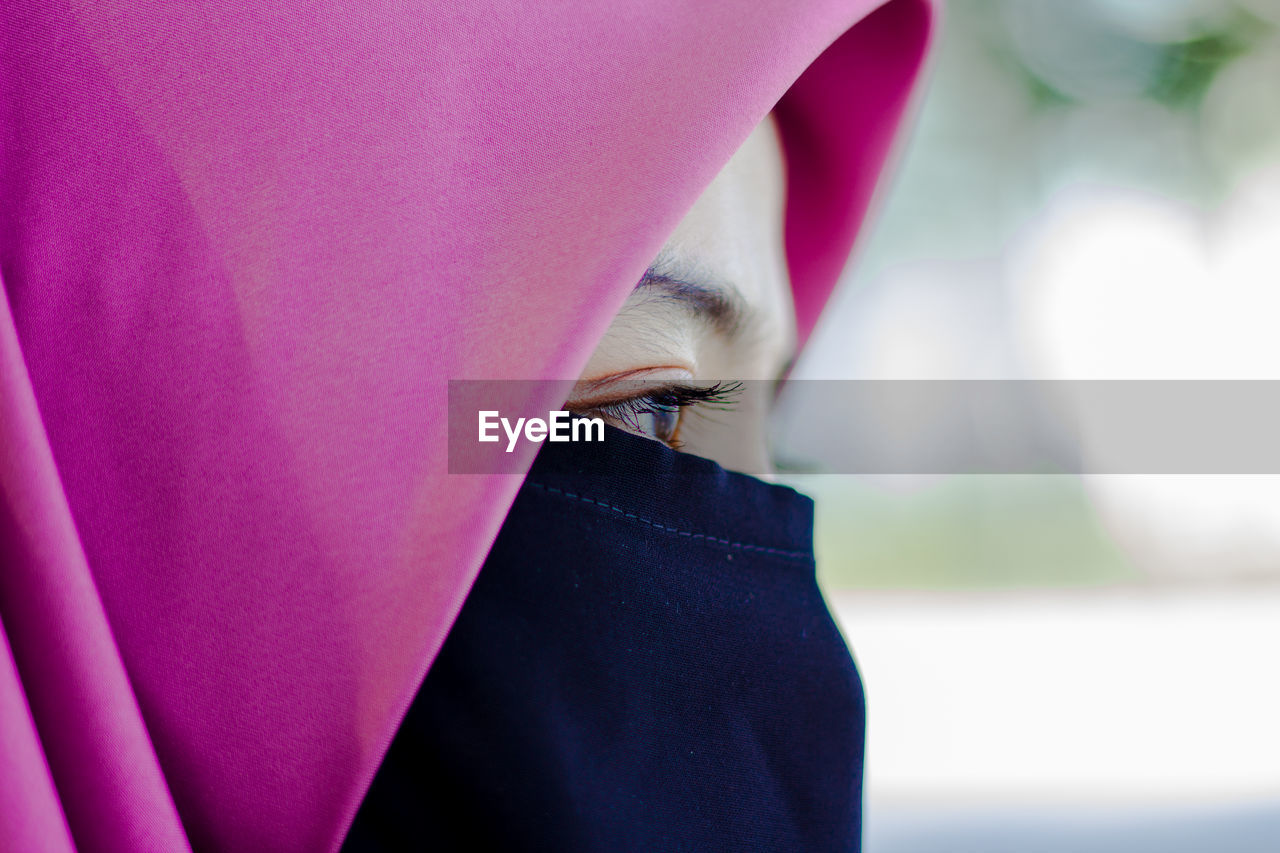 Close-up of woman with pink hijab