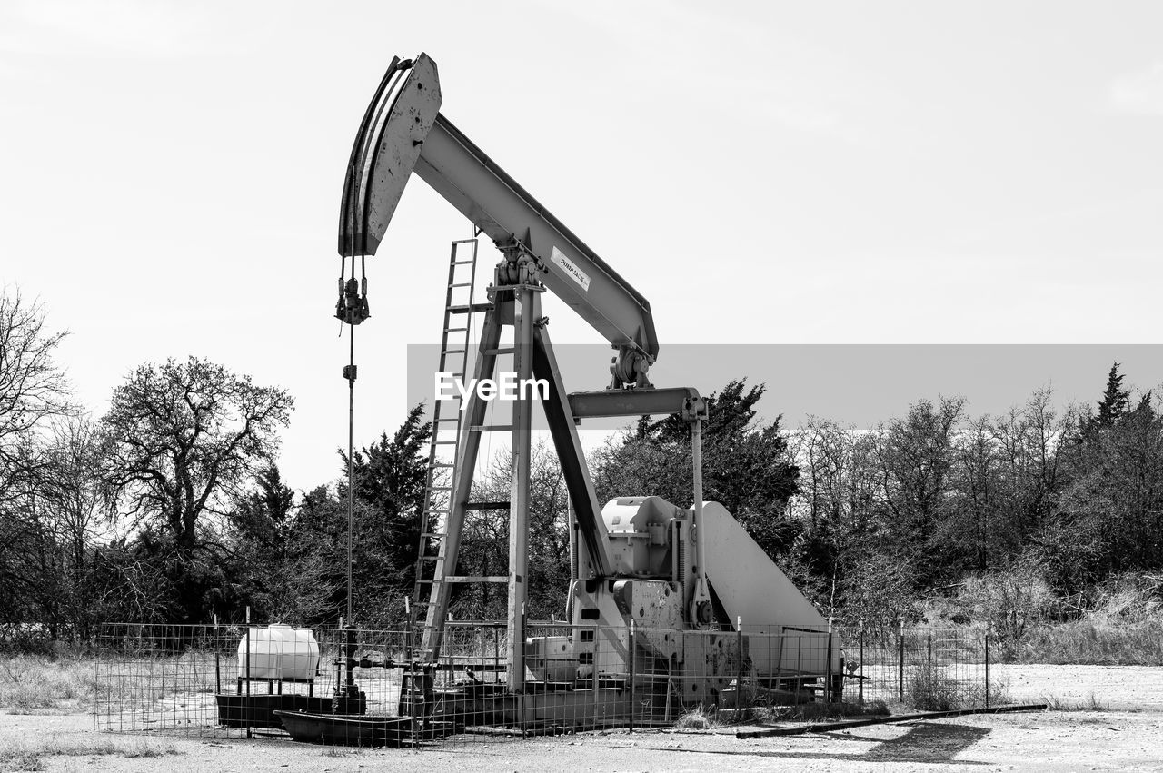oil pump, tree, outdoors, no people, day, oil well, oil industry, industry, sky, drilling rig