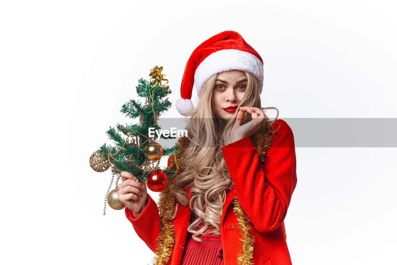 YOUNG WOMAN WITH UMBRELLA IN CHRISTMAS TREE