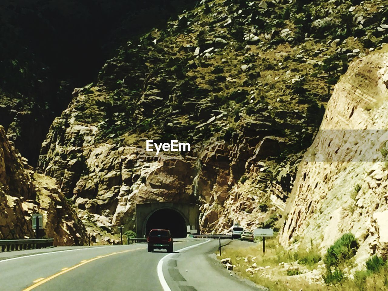 road, transportation, tunnel, the way forward, arch, land vehicle, bridge - man made structure, mode of transport, curve, day, nature, mountain road, winding road, mountain, no people, outdoors, tree