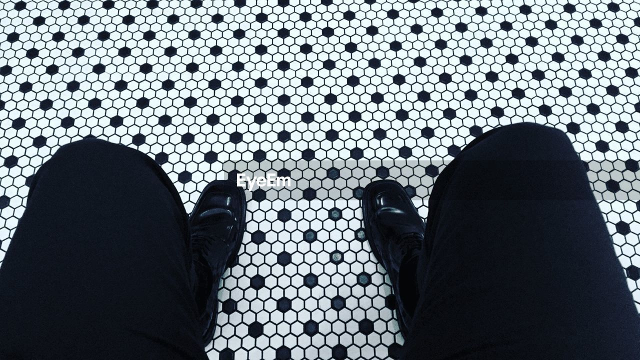 Low Section Of Man On Patterned Floor