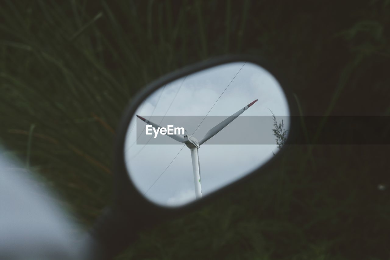 Wind Turbines Reflection On Side-View Mirror
