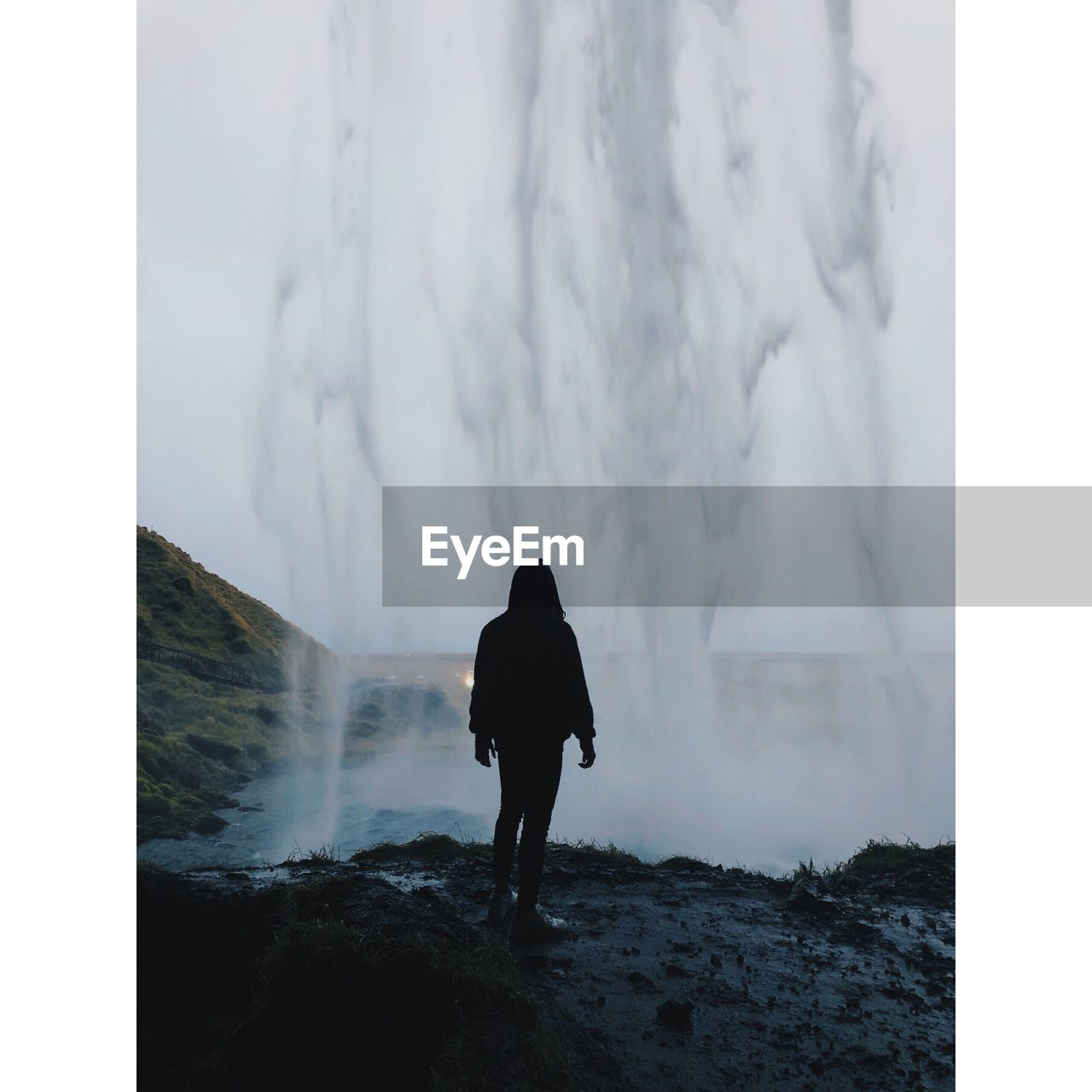 rear view, real people, leisure activity, lifestyles, nature, standing, auto post production filter, one person, water, transfer print, day, walking, beauty in nature, scenics - nature, full length, mountain, land, outdoors, power in nature, looking at view, watching