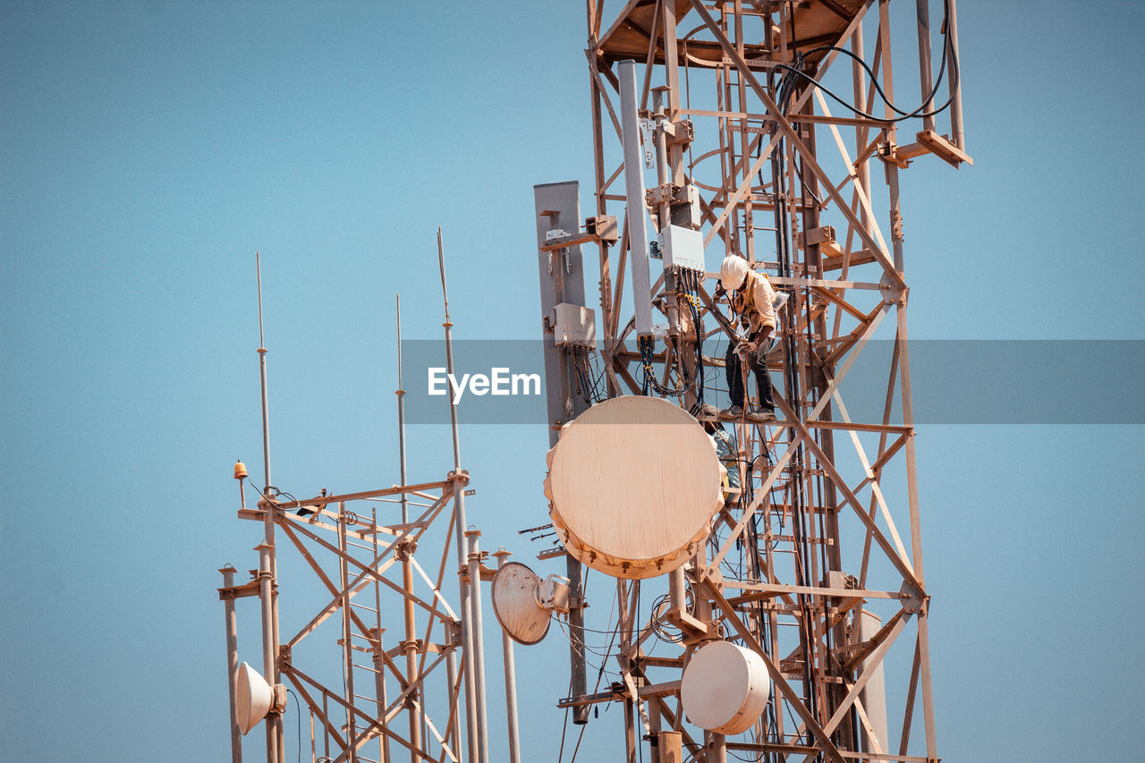 sky, tower, satellite, antenna - aerial, clear sky, technology, satellite dish, low angle view, broadcasting, global communications, nature, no people, architecture, built structure, metal, day, telecommunications equipment, communication, connection, wireless technology, tall - high, outdoors, radio wave, receiving, station