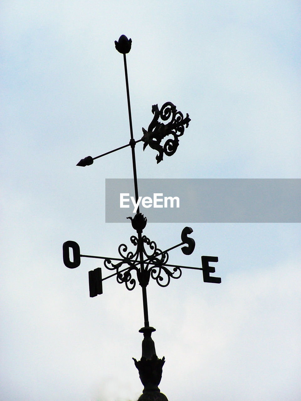 direction, guidance, weather vane, low angle view, communication, day, sky, no people, outdoors, silhouette, cloud - sky, close-up, nature
