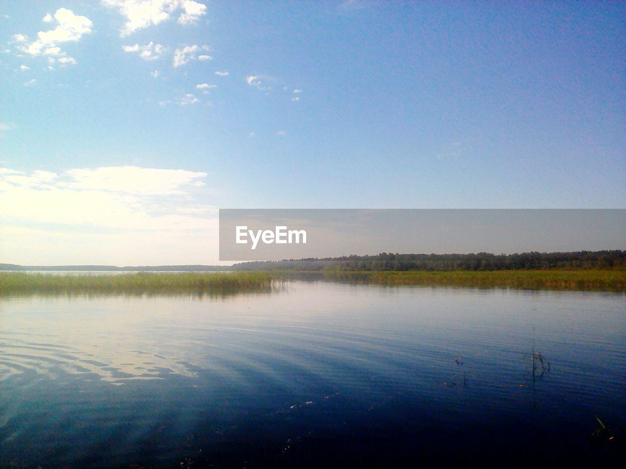 IDYLLIC SHOT OF LAKE AGAINST SKY