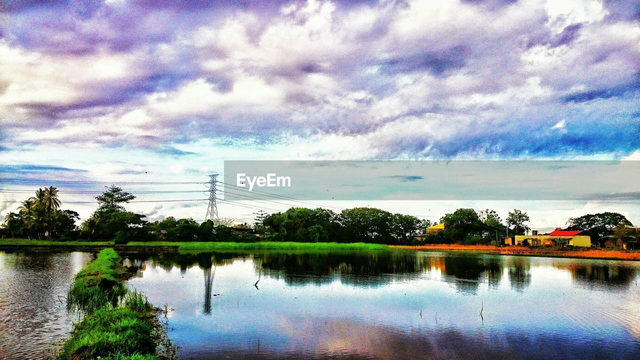 sky, reflection, cloud - sky, water, nature, tree, beauty in nature, tranquil scene, scenics, lake, no people, cable, outdoors, connection, tranquility, day, electricity pylon