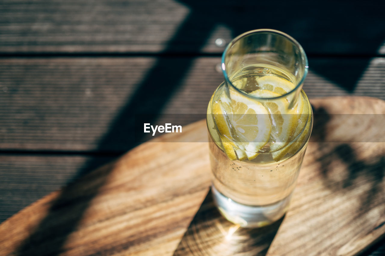 High Angle View Of Lemon Slices In Drink On Table