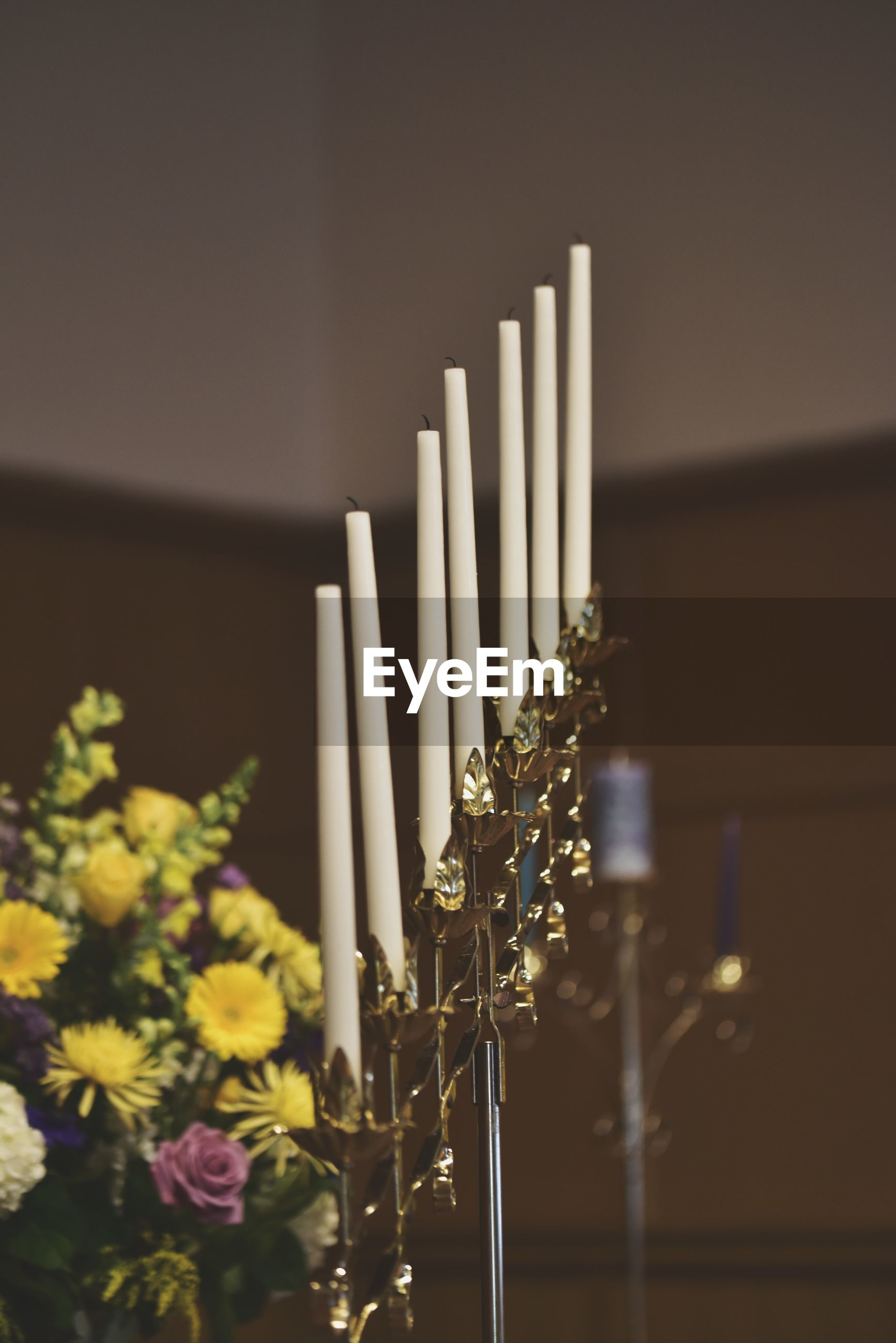Candles on stand on wedding day
