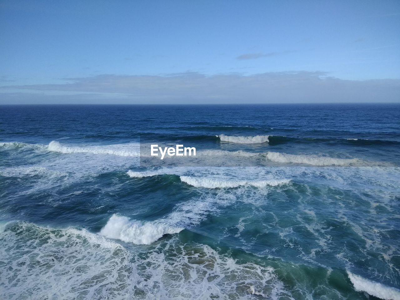 sea, water, scenics - nature, wave, beauty in nature, motion, sport, aquatic sport, surfing, horizon over water, land, horizon, sky, nature, beach, outdoors, waterfront, day, power in nature