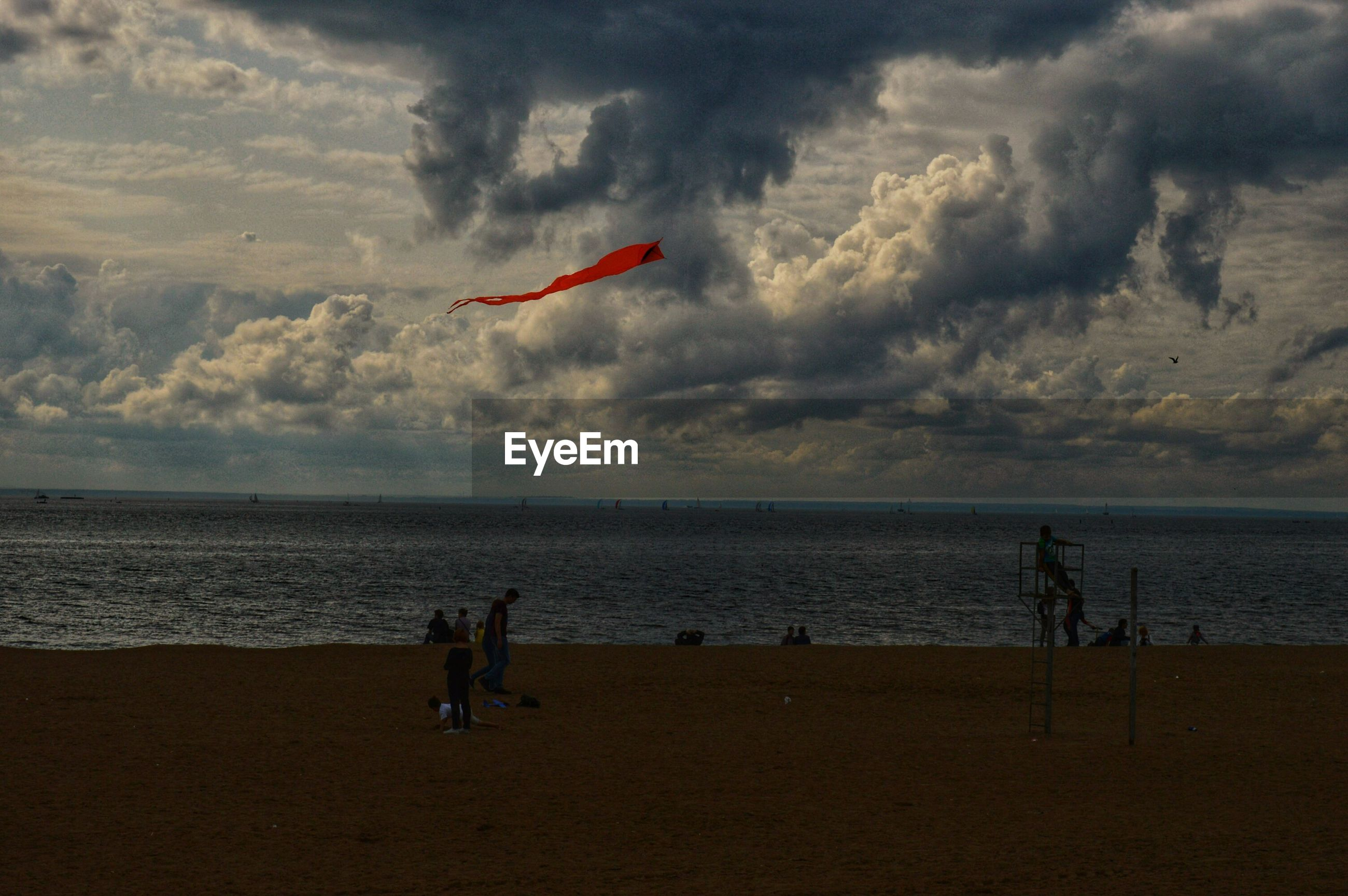 PEOPLE FLYING OVER BEACH