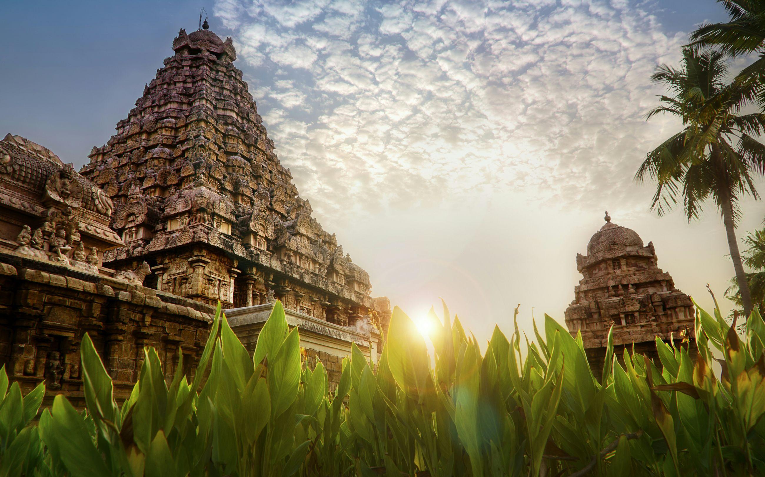 Low angle view of gangaikonda cholapuram temple against cloudy sky