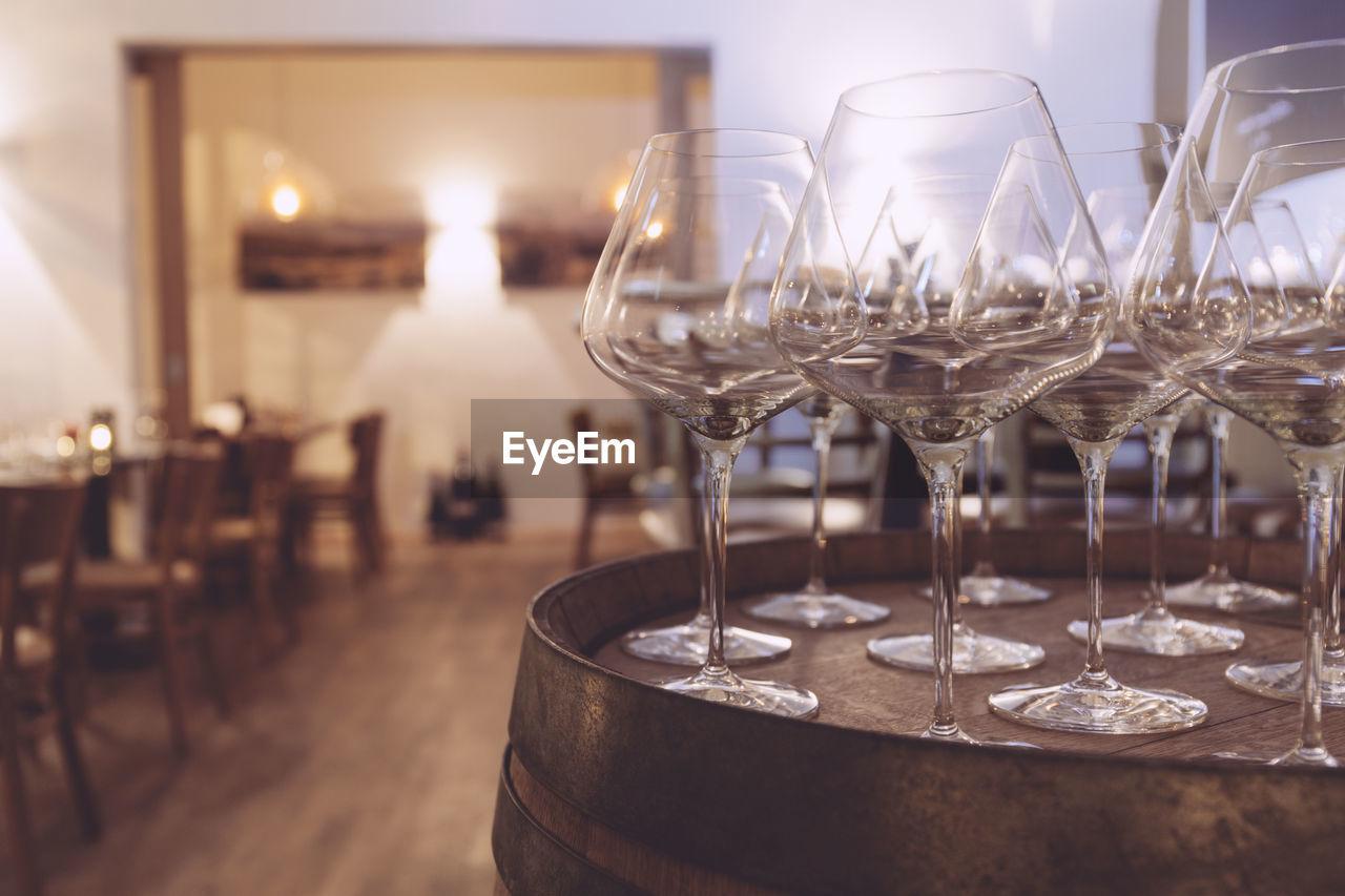 Empty Wineglass On Barrel In Restaurant