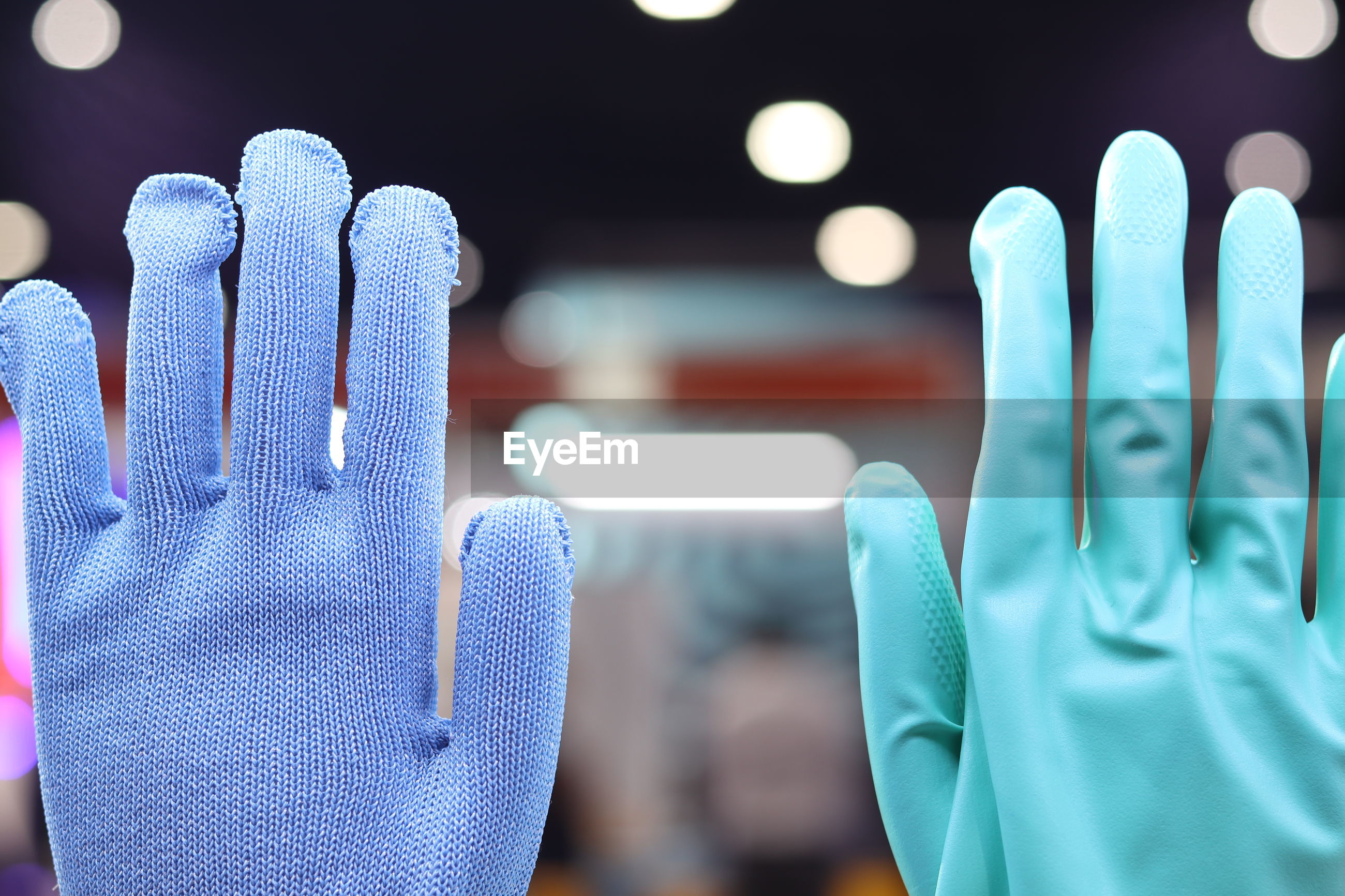 Cropped hands wearing gloves
