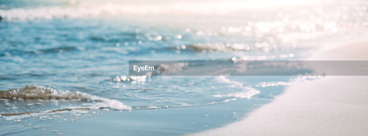 sea, water, beauty in nature, scenics - nature, land, nature, beach, day, no people, motion, tranquility, outdoors, tranquil scene, wave, sunlight, idyllic, sport, selective focus, non-urban scene