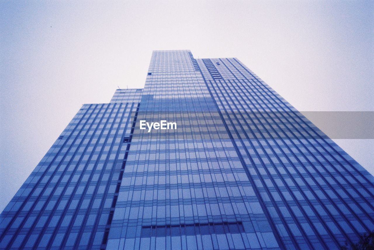 low angle view, architecture, tall, skyscraper, modern, tower, built structure, building exterior, no people, growth, city, clear sky, corporate business, outdoors, sky, day