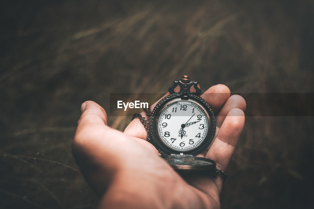 human hand, hand, human body part, holding, one person, real people, time, watch, clock, pocket watch, close-up, unrecognizable person, lifestyles, body part, instrument of time, personal perspective, wristwatch, accuracy, finger, personal accessory, human limb
