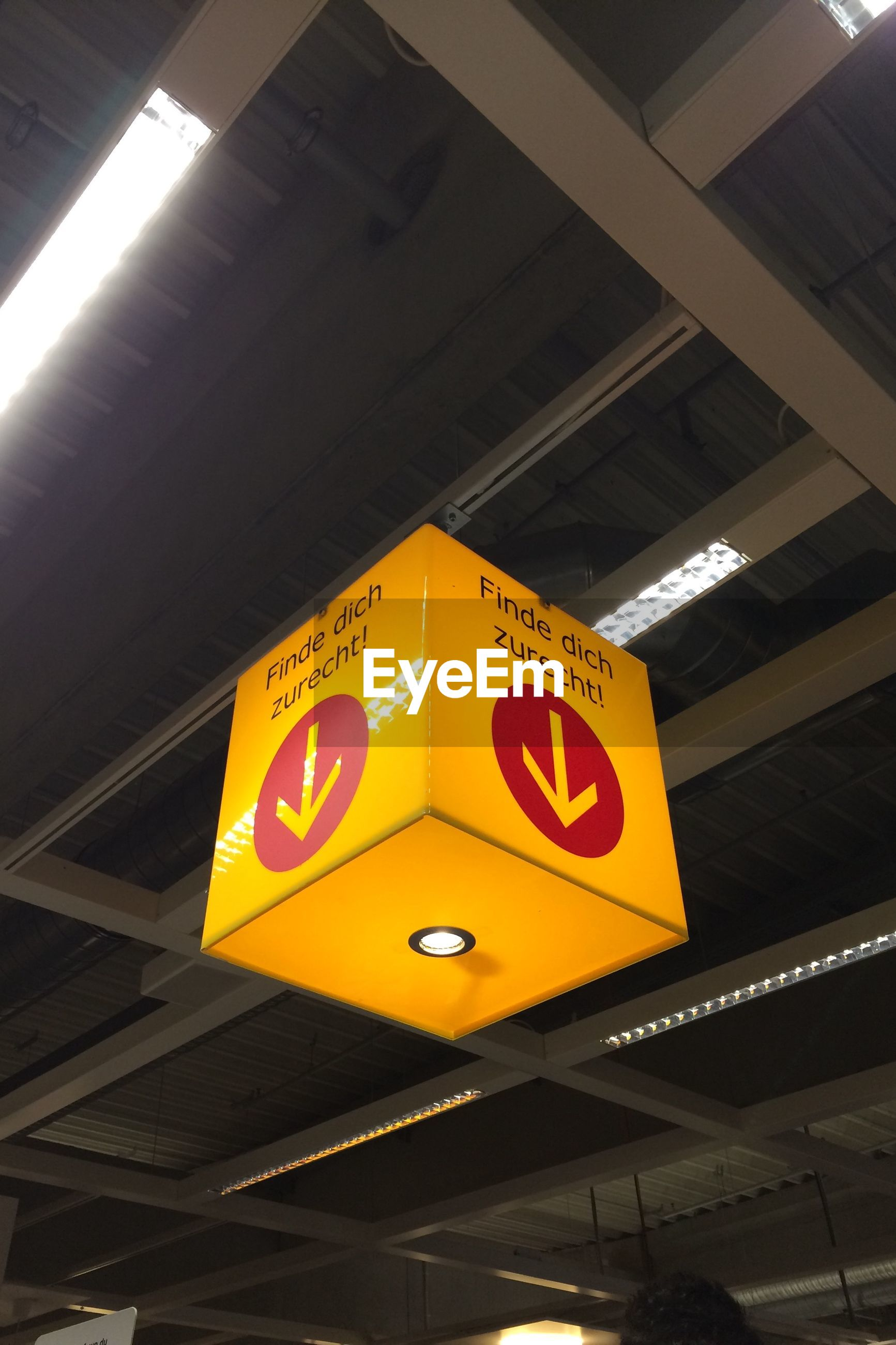 Information sign hanging in ceiling