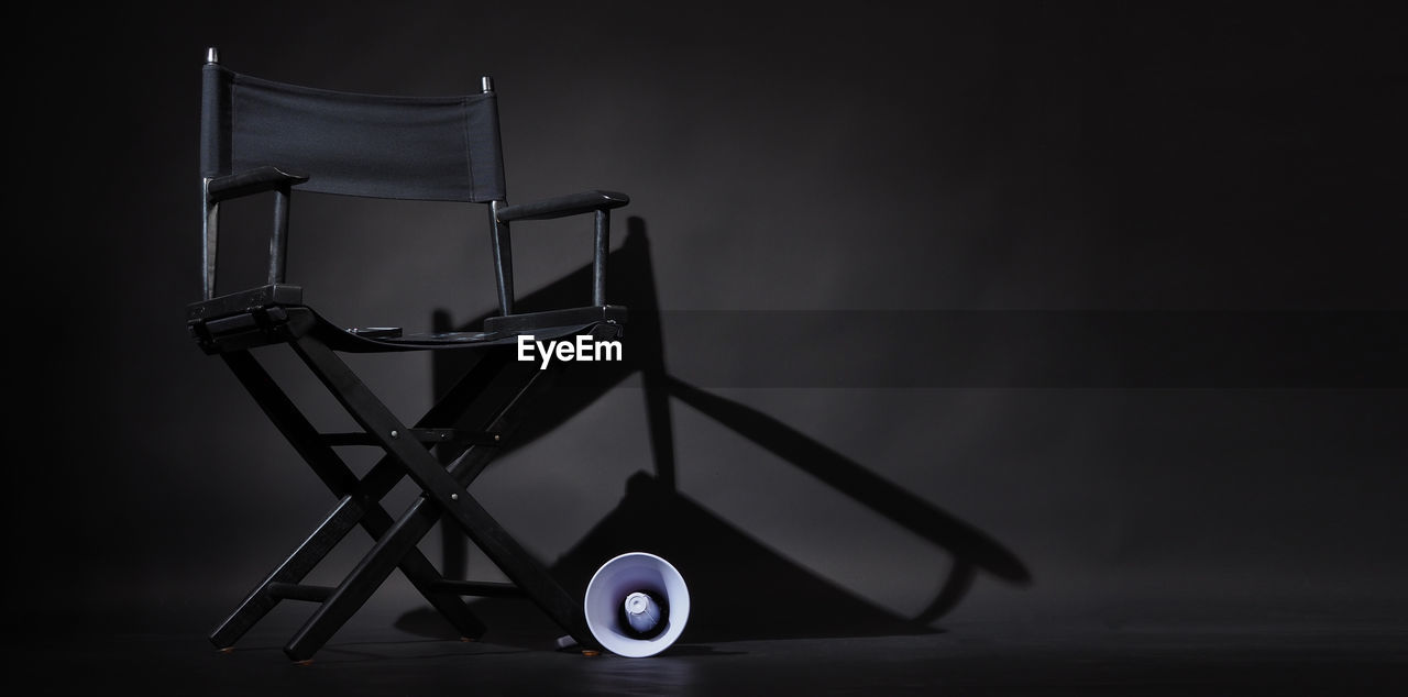 Close-up of chair against black background