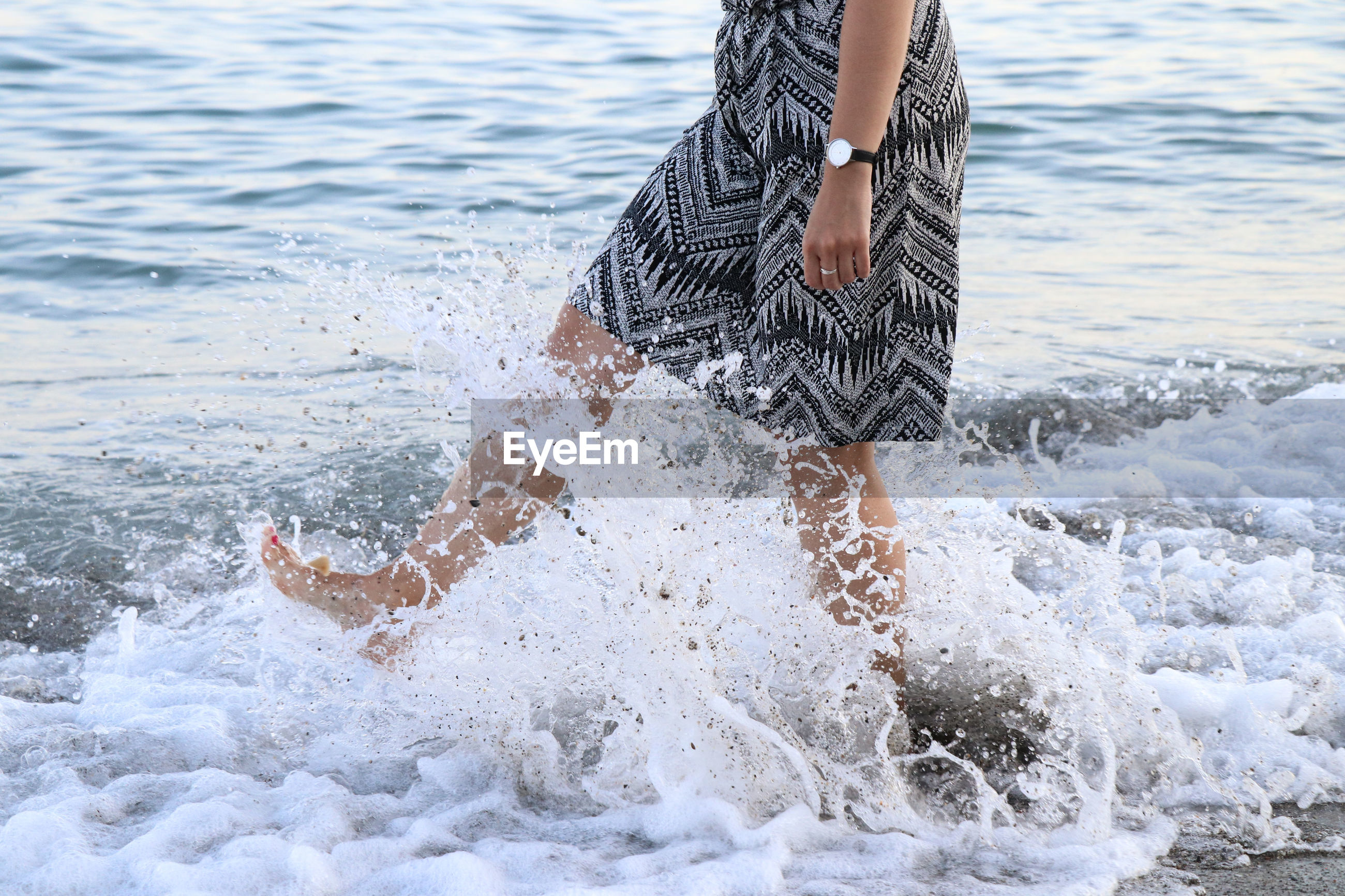Low section of woman at beach