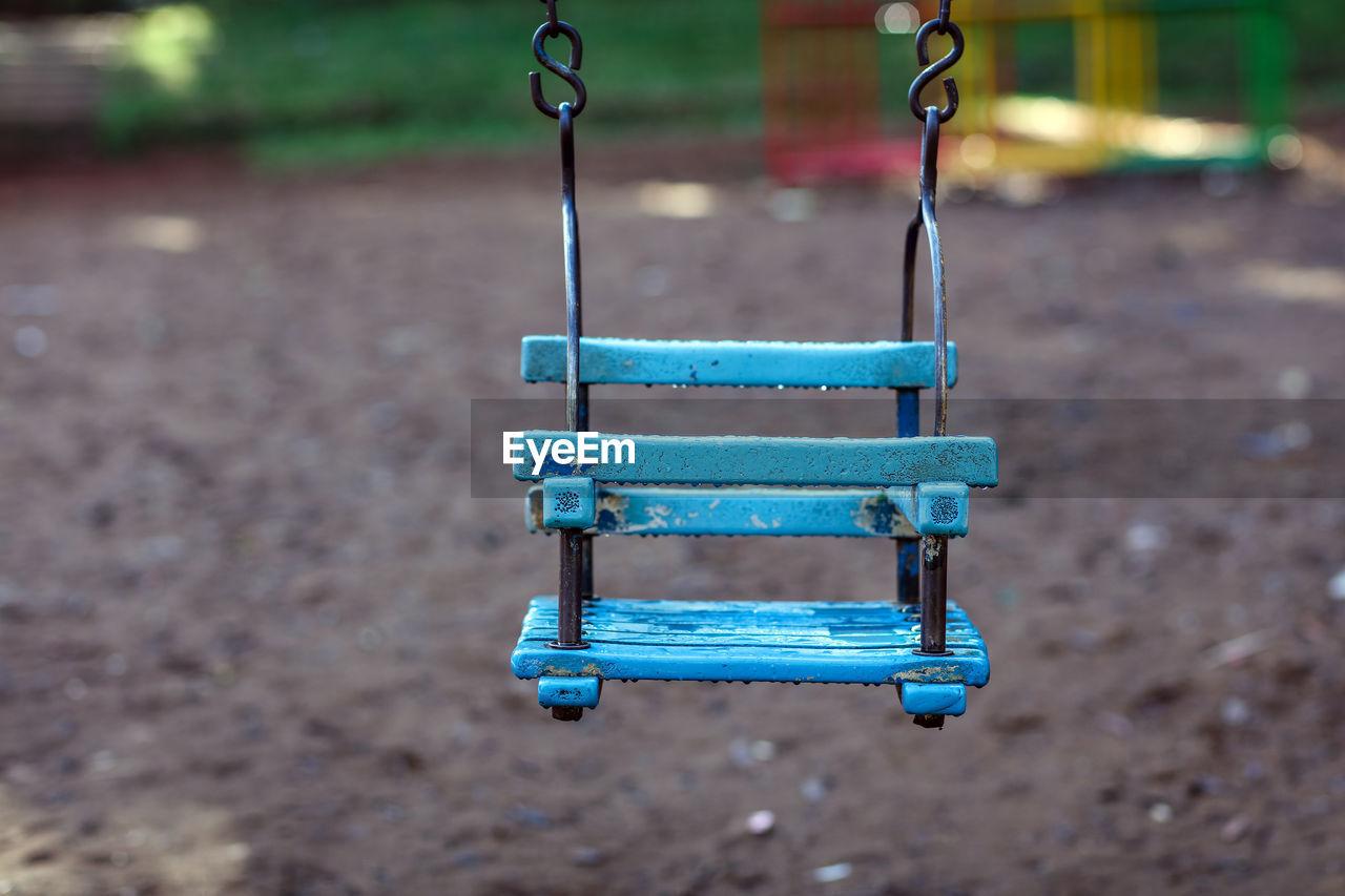 Empty Baby Swing Hanging At Playground