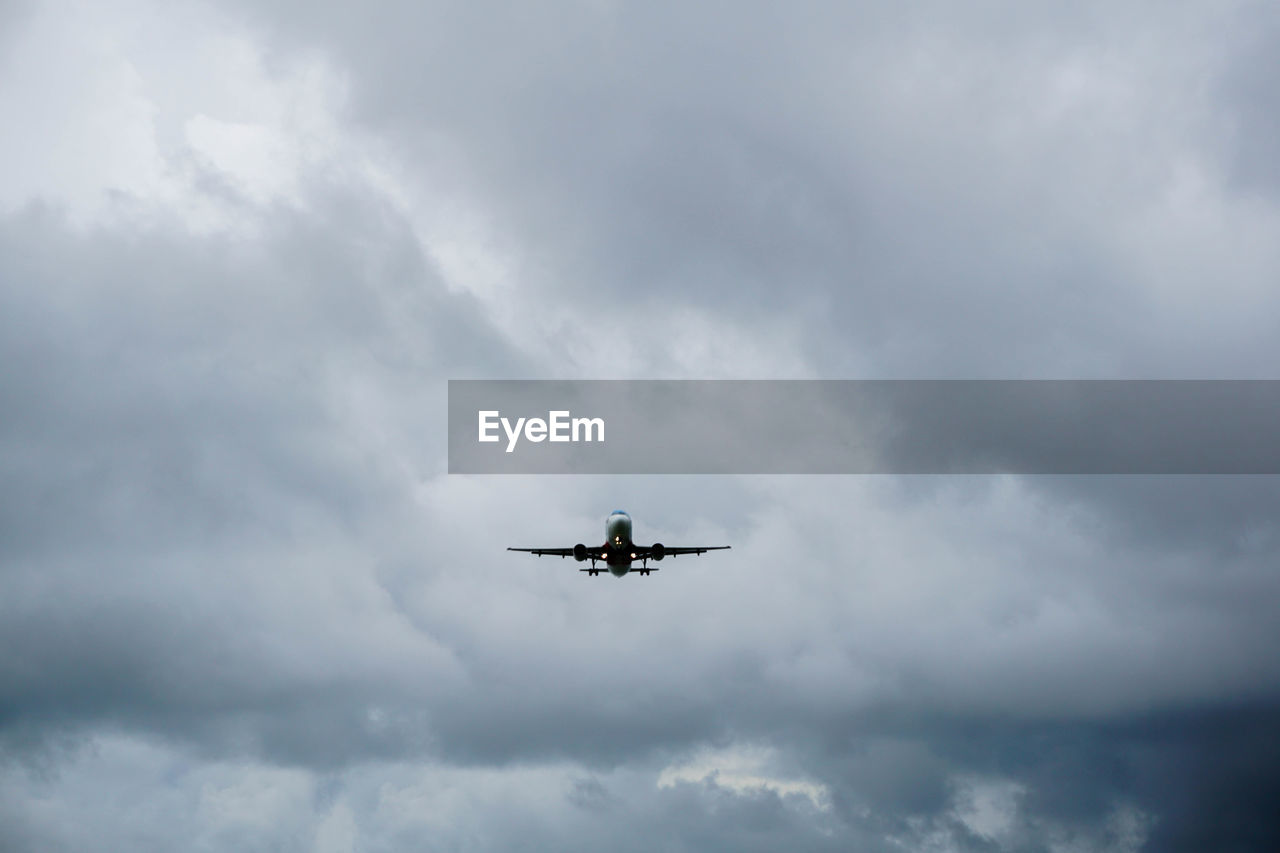 cloud - sky, air vehicle, sky, airplane, transportation, mode of transportation, low angle view, flying, mid-air, nature, no people, on the move, motion, day, overcast, travel, military, outdoors, plane, ominous, aerobatics