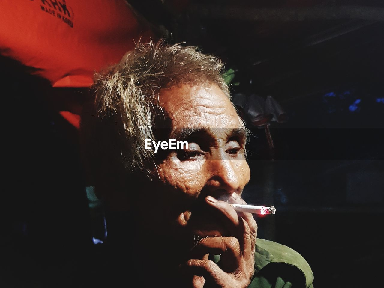 Close-Up Of Senior Man Smoking Cigarette
